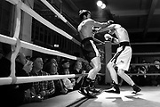 """Amateur Chessboxers Thomas Cazeneuve(left) and Timur Iyubinskii are engaged in a round of boxing during a chessboxing match at the Intellectual Fight Club in Berlin, Germany on the 15th of December 2017. <br /> Chessboxing is a literal combination of chess and boxing in a single match, demanding the players to quickly shift between mental and physical skills. The battle consists of 11 alternating rounds of chess and boxing, each lasting for 3 minutes. A game is won by checkmate, knockout or the judge's decision. <br /> The sport first got conceived of by the Slovak Bosnian comic book creator Enki Bilal, who introduced it in his futuristic graphic novel """"Cold Equator"""". Inspired by the book Dutch artist Iepe Rubingh staged the first fight in Amsterdam in 2003, which he himself fought and won. After that Iepe moved to Berlin and proceeded to found chessboxing-global.com, an organisation that strives to make the new sport popular worldwide."""