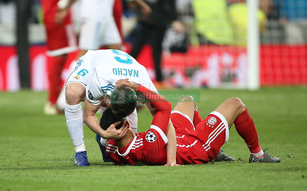 May 1, 2018 - Madrid, Spain - Robert Lewandowski of Bayern Muenchen is consoled by Nacho Fernandez of Real Madrid as they fail to reach the final after the UEFA Champions League Semi Final Second Leg match between Real Madrid and Bayern Muenchen at the Bernabeu on May 1, 2018 in Madrid, Spain. (Credit Image: © Raddad Jebarah/NurPhoto via ZUMA Press)