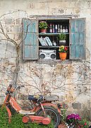 Decoration in window outside bar and old motorcycle, Xidi village, UNESCO World heritage, Anhui province, China