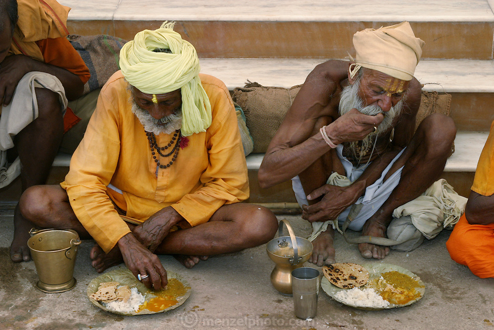 Worshippers eating at Sri Swami Santdas Udaasin Ashram, in Ujjain, India. On the right is Sitarani Tyaagi, one of thousands of ascetic Hindu priests (called Sadhus) that walk the country of India and receive food from observant Hindus. (Sitarani Tyaai is featured in the book What I Eat: Around the World in 80Diets.) Generally he eats one meal per day and has water for the other two meals. He has a small pot that he carries with him for water. He is 70 years of age; 5 feet, 6 inches tall; and 103 pounds.
