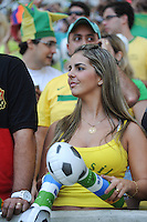 Local girl fan. Crowd in stadium. Brazil v England  football match, Maracana stadium, Rio de Janeiro, Brazil. 2nd June 2013.