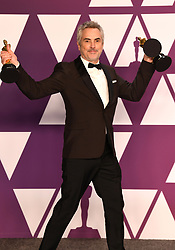 "Alfonso Cuaron, winner of the Best Director Award, Best Foreign Film Award and Best Cinematography Award for ""Roma"" at the 91st Annual Academy Awards"