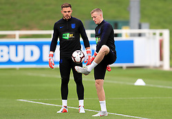 England goalkeeper Jordan Pickford (right) and Jack Butland during the training session at St Georges' Park, Burton. PRESS ASSOCIATION Photo. Picture date: Monday September 10, 2018. See PA story SOCCER England. Photo credit should read: Mike Egerton/PA Wire. RESTRICTIONS: Use subject to FA restrictions. Editorial use only. Commercial use only with prior written consent of the FA. No editing except cropping.