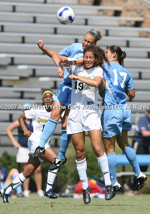 23 September 2007: San Francisco's Fiona O'Sullivan (19) and North Carolina's Erin Mikula (38) and Yael Averbuch (17) challenge for a header. The University of North Carolina Tar Heels defeated the University of San Francisco Dons 2-0 at Koskinen Stadium in Durham, North Carolina in an NCAA Division I Women's Soccer game, and part of the annual Duke Adidas Classic tournament.