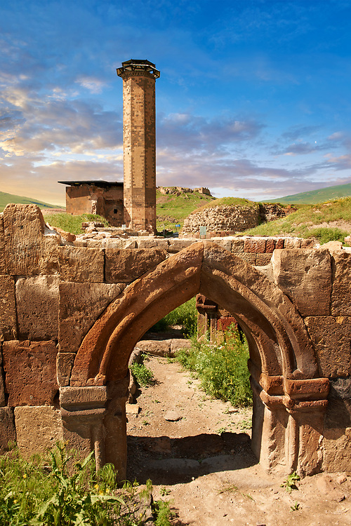 Medieval Gothic Door Arch infront of The Seljuk Turk Mosque of Ebul Minuchihr (Minuchir) built in 1072, Ani archaelogical site on the ancient Silk Road  , Kars , Anatolia, Turkey .<br /> <br /> If you prefer to buy from our ALAMY PHOTO LIBRARY  Collection visit : https://www.alamy.com/portfolio/paul-williams-funkystock/ani-turkey.html<br /> <br /> Visit our TURKEY PHOTO COLLECTIONS for more photos to download or buy as wall art prints https://funkystock.photoshelter.com/gallery-collection/3f-Pictures-of-Turkey-Turkey-Photos-Images-Fotos/C0000U.hJWkZxAbg