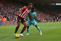 Football - 2018 / 2019 Premier League - Southampton vs. Newcastle United<br /> <br /> Southampton's Mario Lemina grabs Christian Atsu of Newcastle by the shorts during the Premier League match at St Mary's Stadium Southampton  <br /> <br /> COLORSPORT/SHAUN BOGGUST