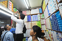 JAKARTA, Sept. 7, 2016 (Xinhua) -- Plainclothes police officers examine medicines during a raid to discover fake and expired medicines of various types inside a drugstore in Jakarta, Indonesia, Sept. 7, 2016. (Xinhua/Zulkarnain).****Authorized by ytfs* (Credit Image: © Zulkarnain/Xinhua via ZUMA Wire)