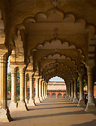 Agra Fort, is a monument, a UNESCO World Heritage site located in Agra, Uttar Pradesh, India. It is about 2.5 km northwest of its more famous sister monument, the Taj Mahal. The fort can be more accurately described as a walled city. Agra Fort was originally a brick fort, held by the Hindu Sikarwar Rajputs. It was mentioned for the first time in 1080 AD when a Ghaznavide force captured it. ikandar Lodi (1488–1517) was the first Sultan of Delhi who shifted to Agra and lived in the fort. He governed the country from here and Agra assumed the importance of the second capital. He died in the fort at 1517 and his son, Ibrahim Lodi, held it for nine years until he was defeated and killed at Panipat in 1526. Several palaces, wells and a mosque were built by him in the fort during his period. An interesting mix of Hindu and Islamic architecture is found here. In fact, some of the Islamic decorations feature haraam (sinful) images of living creatures – dragons, elephants and birds, instead of the usual patterns and calligraphy seen in Islamic surface decoration.
