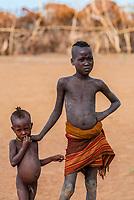 Dassanach tribe boys playing near their village, near Omorate, Omo Valley, Ethiopia.