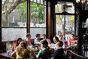 The Crown. A popular pub for beer and food in Islington, London. Attracts both older customers and a young crowd.