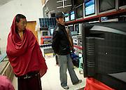Tibetans shop for television sets in Lhasa.