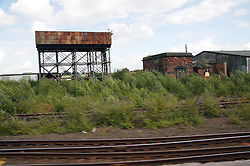 View of old buildings from the window of a speeding train,