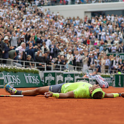 PARIS, FRANCE June 09.  Rafael Nadal of Spain lies on the clay court as he celebrates winning his twelfth French Open title after his victory against Dominic Thiem of Austria during the Men's Singles Final on Court Philippe-Chatrier at the 2019 French Open Tennis Tournament at Roland Garros on June 9th 2019 in Paris, France. (Photo by Tim Clayton/Corbis via Getty Images)
