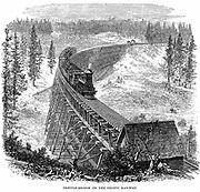Union Pacific Railroad: Train crossing wooden trestle bridge carrying railroad across the Sierra Nevada. Wood engraving 1876
