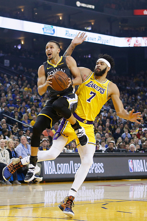 Golden State Warriors guard Stephen Curry (30) shoots against Los Angeles Lakers center JaVale McGee (7) in the first half of an NBA game at Oracle Arena on Saturday, Feb. 2, 2019, in Oakland, Calif. The Warriors won 115-101.