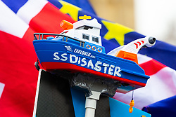 """A toy boat dubbed """"SS Disaster"""", a jibe at the Government's awarding of a contract in the event of a hard Brexit to a ferry company that has no ships, is taped to a pole used by anti-Brexit and People's Vote Campaigner Steve Bray to disrupt TV broadcasts on College Green outside Parliament where small numbers of both both Remain and Leave protesters are demonstrating. London, January 07 2019."""