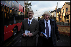 London Mayor Boris Johnson and his brother Jo Johnson MP for Orpington campaigning in Orpington before a rally in Orpington, London, with the PM during the Mayoral Campaign, Tuesday April 18, 2012. Photo By Andrew Parsons/I-images