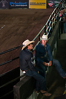 KELOWNA, CANADA - JULY 7:  Thirty-One year old rider Aaron Roy of Yellowgrass Saskatchewan, sits on the rails with Lane Skori of Skori Bucking Bulls prior to the Monster Energy Pro Bull Riding tour on July 7, 2018 at Prospera Place in Kelowna, British Columbia, Canada.  (Photo by Marissa Baecker/Shoot the Breeze)  *** Local Caption ***