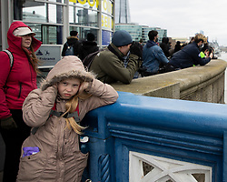 © Licensed to London News Pictures.10/04/2021. London, UK. A young girl covers her ears as the Honourable Artillery Company fire a salute at The Tower of London to mark the death of Prince Philip. Gun salutes are taking place across the UK and on Royal Navy ships. Yesterday Buckingham Palace announced that Prince Philip The Duke of Edinburgh passed away in the morning at Windsor Castle . Photo credit: George Cracknell Wright/LNP