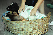 BANGKOK, March 15, 2016<br /> A staff covers a sleeping baby orangutan with a blanket at a zoo in suburban Bangkok, Thailand, March 15, 2016. <br /> ©Exclusivepix Media