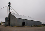 """Some grain is stored in """"flat storage"""" in buildings such as this at Minco Grain and Supply."""