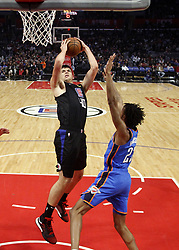 March 8, 2019 - Los Angeles, California, U.S - Los Angeles Clippers' Ivica Zubac (40) goes to basket while defended by Oklahoma City Thunder's Terrance Ferguson (23) during an NBA basketball game between Los Angeles Clippers and Oklahoma City Thunder Friday, March 8, 2019, in Los Angeles. (Credit Image: © Ringo Chiu/ZUMA Wire)