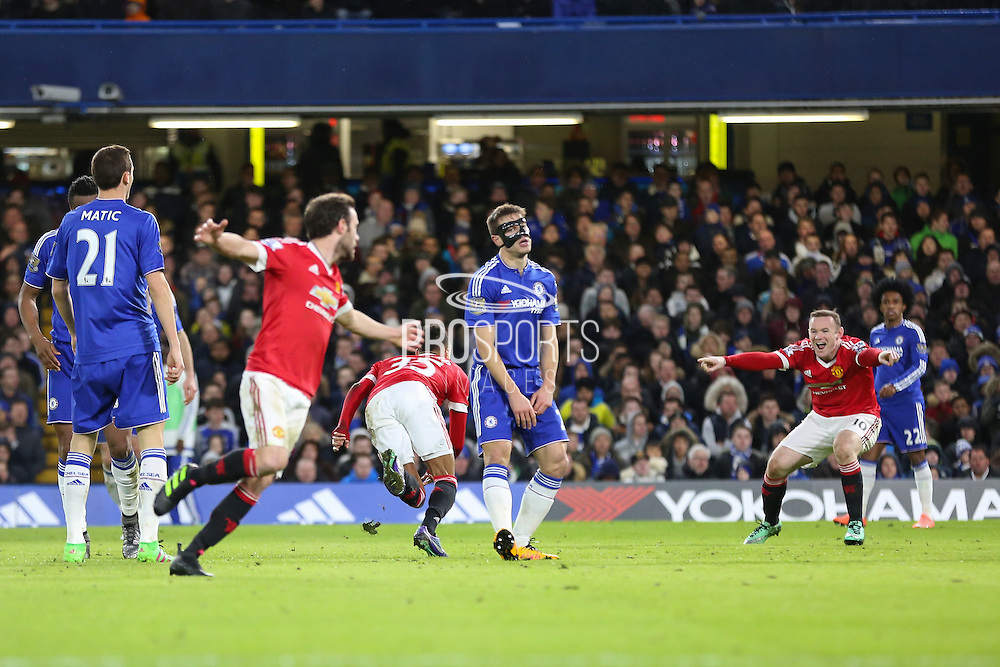 Jesse Lingard of Manchester United and Wayne Rooney of Manchester United celebrate Jesse Lingard of Manchester United goal 0-1 during the Barclays Premier League match between Chelsea and Manchester United at Stamford Bridge, London, England on 7 February 2016. Photo by Phil Duncan.