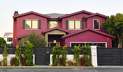 EXCLUSIVE: Bella Thorne painted her new 2 million dollar cape code style house purple. The starter mansion was originally painted cape cod white, the same design as her neighbors who live directly behind her. Her neighbors have said they are extremely upset at the color as well as getting fed up with her loud and obnoxious late night rave parties. 07 Aug 2017 Pictured: Bella Thorne's purple house. Photo credit: CHEEN / MEGA TheMegaAgency.com +1 888 505 6342