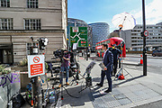April 7, 2020, London, England, United Kingdom: Journalists set up and wait outside St Thomas' Hospital in central London as British Prime Minister Boris Johnson is in intensive care fighting the coronavirus in London, Tuesday, April 7, 2020. Johnson was admitted to St Thomas' hospital in central London on Sunday after his coronavirus symptoms persisted for 10 days. Having been in the hospital for tests and observation, his doctors advised that he be admitted to intensive care on Monday evening. (Credit Image: © Vedat Xhymshiti/ZUMA Wire)