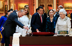 The Duke of Edinburgh (first left) First Lady of Mexico Angelica Rivera (second left) President of Mexico Enrique Pena Nieto (third left) and Queen Elizabeth II (first right) view a display of Mexican items in the Royal Collection by at Buckingham Palace, London, during the first of a three-day state visit to Britain.