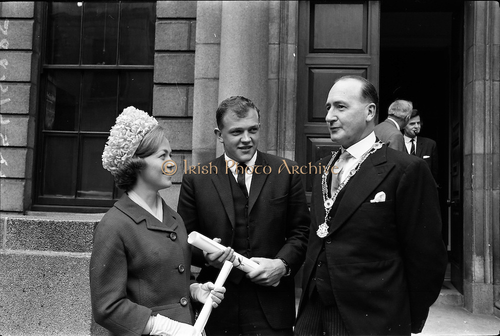 14/06/1963.06/14/1963.14 June 1963.Presentation of Admission Parchments at Solicitors Building of the Four Courts Dublin. Helen M. Kirwan, (B.C.L.), Hillery, Howth Road, Raheny, Dublin and Mr. Garrett P. Lombard, Avenue House, Gorey, Co. Wexford, two of the new solicitors who received their admission parchments from Mr. Francis Lanigan, President of the Incorporated Law Society (right). Mr Lombard was awarded a special certificate.
