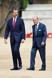© Licensed to London News Pictures. 12/07/2017. London, UK. King Felipe VI of Spain and Prince Philip, The Duke of Edinburgh inspecting Ceremonial Guard of Honour on Horse Guards Parade in London on the first day of State visit of the King and Queen of Spain. Photo credit: Tolga Akmen/LNP