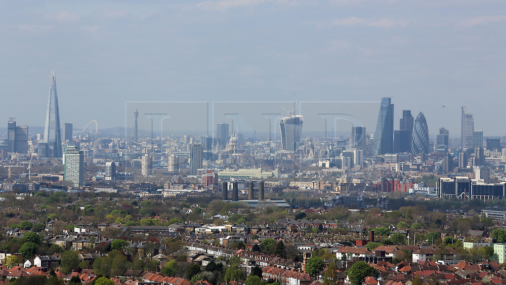© Licensed to London News Pictures. 14/04/2014. City of London skyline as seen from Severndroog Castle in SE London. A 18th century castle on a hill in south east London is preparing to reopen as its restoration nears completion. Severndroog Castle in Oxleas Woods on Shooters Hill enjoys stunning views across five counties. The folly has been closed for many years and was in state of disrepair before work started on a restoration project last year. The historic building featured in the BBC series Restoration in 2004. Reopening date yet to be confirmed, more information available fron the Severndroog Castle Building Presevation Trust . Credit : Rob Powell/LNP