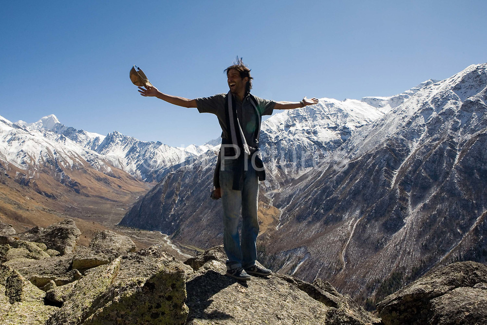 An Indian man on top of a mountain showing joy, 20th October 2009, Himachal Pradesh, India. The region of Spiti and Kinnaur is a remote and tribal area of the Indian Himalayas near the Tibetan border.