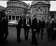 Newly Elected TD Enda Kenny Arrives at The Dail..(J89)..1975..18.11.1975..11.18.1975..18th November 1975..Following the death of his father,Henry Kenny TD, Enda Kenny was proposed by the Fine Gael party to contest the seat. He was duly elected and went to Dublin to take up his seat in Dail Eireann at Leinster House, Dublin. .Image of Enda Kenny being greeted by An Taoiseach and Party Leader Mr Liam Cosgrave TD on his arrival at Leinster House.