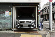 big car parked in small garage