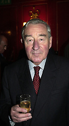 CAPT.SIR ALASTAIR AIRD private secretary to HM The Queen Mother, at a party in London on 24th February 2000.OBO 34