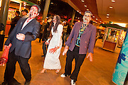 """Oct. 30, 2009 -- PHOENIX, AZ: Zombies walk through a downtown shopping development during the Zombie Walk in Phoenix Friday night. About 200 people participated in the first """"Zombie Walk"""" in Phoenix, AZ, Friday night. The Zombies walked through downtown Phoenix """"attacking"""" willing victims and mixing with folks going to the theatre and downtown sports venues.  Photo by Jack Kurtz"""