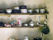 Pots and pans in a typical Bhutanese farmhouse kitchen, Gyenshari village, Western Bhutan