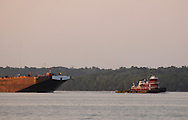 Cornwall-on-Hudson, New York - The tugboat Justine McAllister pulls a barge down the Hudson River at sunset on June 15, 2011.
