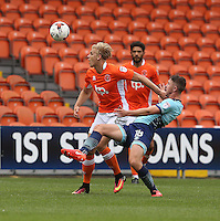 Blackpool's Brad Potts avoids the challenge from Wycombe Wanderers' Dan Rowe<br /> <br /> Photographer Stephen White/CameraSport<br /> <br /> Football - The EFL Sky Bet League Two - Blackpool v Wycombe Wanderers - Saturday 20 August 2016 - Bloomfield Road - Blackpool<br /> <br /> World Copyright © 2016 CameraSport. All rights reserved. 43 Linden Ave. Countesthorpe. Leicester. England. LE8 5PG - Tel: +44 (0) 116 277 4147 - admin@camerasport.com - www.camerasport.com