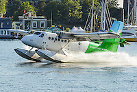 A Westcoast Air De Havilland DHC-6 Twin Otter lands near the Inner Harbour in Victoria, British Columbia