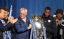 Leicester City Manager Claudio Ranieri (C) and Wes Morgan hold up the trophy to fans at Victoria park during the victory celebrations  - Mandatory by-line: Jack Phillips/JMP - 16/05/2016 - FOOTBALL - Leicester City FC, Sky Bet Premier League Winners 2016 - Leicester City Victory Parade