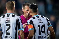 (L-R) Tim Breukers of Heracles Almelo, referee Danny Makkelie, Joey Pelupessy of Heracles Almelo during the Dutch Eredivisie match between Heracles Almelo and Feyenoord Rotterdam at Polman stadium on September 09, 2017 in Almelo, The Netherlands
