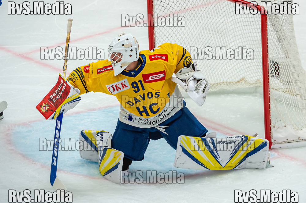 LAUSANNE, SWITZERLAND - SEPTEMBER 24: Goalie Gilles Senn #91 of HC Davos makes a stick save during the Swiss National League game between Lausanne HC and HC Davos at Vaudoise Arena on September 24, 2021 in Lausanne, Switzerland. (Photo by Robert Hradil/RvS.Media)