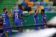 Goal 0-1 by Mateo Cassierra that celebrates with teammates during the Liga NOS match between Sporting Lisbon and Belenenses SAD at Estadio Jose Alvalade, Lisbon, Portugal on 21 April 2021.