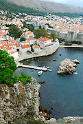 Elevated view from Fortress Lovrinjenac (Fort of Saint Lawrence) of Dubrovnik's oldest harbour, Kalarinja, and Dubrovnik old town