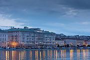 Seafront showing Savoia Excelsior Palace Hotel at dusk, Trieste, Italy