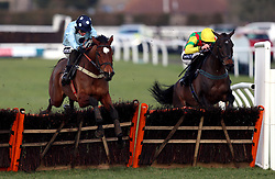 Baddesley Knight ridden by jockey Tom Cannon (who finished third) and Acey Milan ridden by jockey Aidan Coleman (winner right) clears a fence during the Happy Birthday Kim Shaw Novices' Hurdle during the Injured Jockeys Fund Charity Raceday at Plumpton Racecourse.
