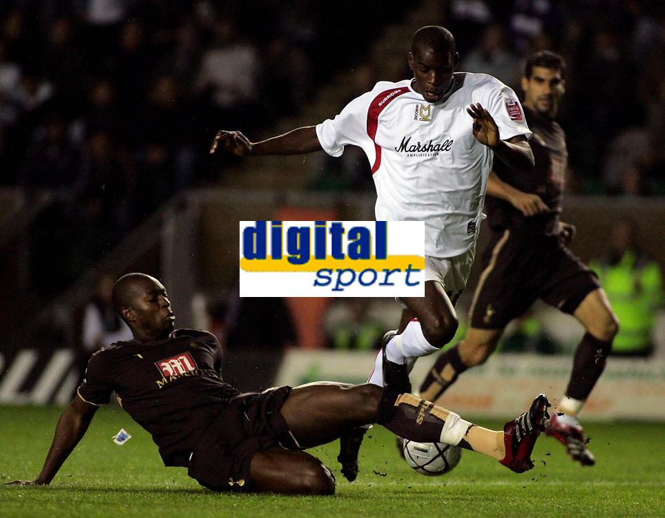 Photo: Marc Atkins.<br /> Milton Keynes Dons v Tottenham Hotspur. Carling Cup. 25/10/2006. Athony Gardner of Spurs slides in on Clive Platt.